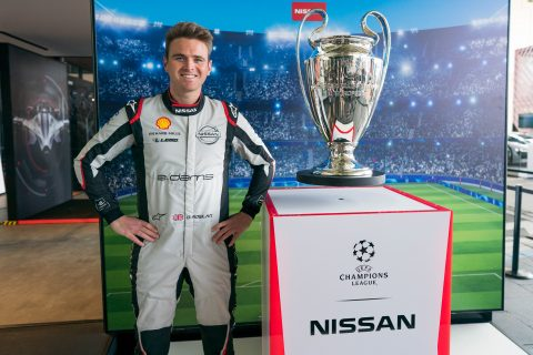 Nissan e.dams drivers Sebastien Buemi and Oliver Rowland pose with the UEFA Champions League trophy today at the Berlin E-Prix.