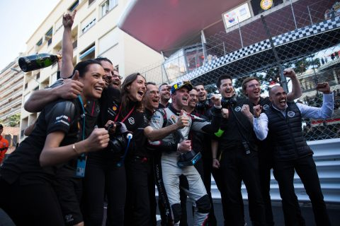 Nissan e.dams racer Oliver Rowland celebrates on the podium in second place at the Monaco E-Prix.